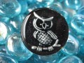 Fancy ring, silver owl, on black resin background
