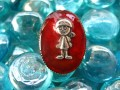 Small oval ring, little boy, on a red resin background
