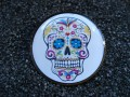 Steampunk brooch, Mexican skull on a white background, set with resin