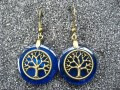 Zen earrings, Bronze tree of life, on blue resin background