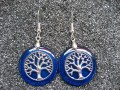 Zen earrings, Silver tree of life, on blue resin background