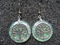 Zen earrings, Silver tree of life, on pearl white background in resin