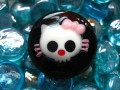 Large Kawaii ring, death head, on black resin background