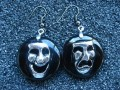 Asymmetrical earrings, Laugh and cry, on black resin