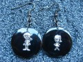 Asymmetrical earrings, Boy Girl, on black resin