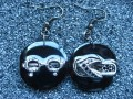 Asymmetrical earrings, Beach Fashion, on black resin