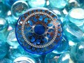 Large ring, silver Mandala print, on blue background, in resin