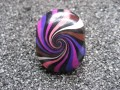 Oval ring, black / plum spiral, in fimo