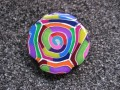RING graphic, multicolored spiral, in fimo