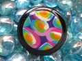 Very large ring, cabochon multicolored motifs in Fimo, on black resin