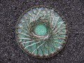 Very large brooch, bronze netting, on pearly white resin