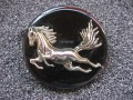 Large fantasy brooch, silver galloping horse, on a black resin background