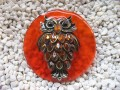 Very large brooch, bronze owl, on orange resin background