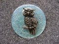 Very large brooch, bronze owl, on pearly white resin