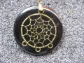 Dreamcatcher pendant bronze, on black resin