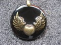 Steampunk pendant Winged heart bronze, on black resin