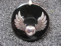 Steampunk Silver Winged Heart Pendant on Black Resin Background