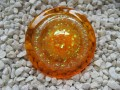 Very large ring, orange glitter cabochon, on a pearly white and orange background, in resin