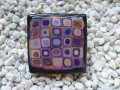 Very large square ring, mosaic plum / gold, on a black background in fimo