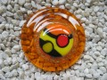 Very large ring, multicolored cabochon in fimo, on resin orange background