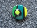 Small graphic ring, green / yellow / black, in Fimo