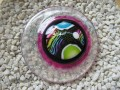 Very very large graphic ring, multicolored cabochon in fimo, on a white and fuchsia background resin