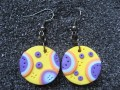 Small pop earrings, blue / plum / orange patterns, on a yellow Fimo background