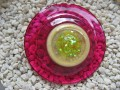 Very very large graphic ring, yellow cabochon, on resin fuchsia background