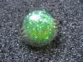 Small cabochon ring, iridescent green glitter, in resin