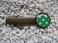 Hair clip, small cabochon, yellow polka dots on a green background, set with resin