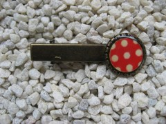 Hair clip, small cabochon, white dots on a red background, set in resin