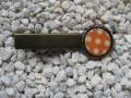 Hair clip, small cabochon, white dots on orange background