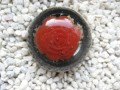 Large cabochon ring, red flower, on black resin