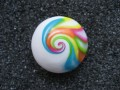 Cabochon ring, multicolored spiral, on white background Fimo