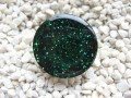 Fancy ring, green glitter, on transparent resin background