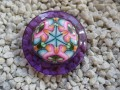 Large fancy ring, cabochon fimo, on plum resin background