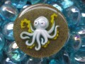 Very large fancy ring, Cartoon Octopus, on a resin sand background