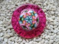 Very large ring, multicolored cabochon in fimo, on resin fuchsia background