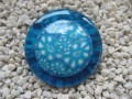 Very large ring, turquoise cabochon, on a blue resin background