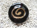 Very large ring, gold spiral glass, on black resin