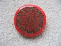 Very large ring, Mandala Bronze Stamp, on a red Fimo background
