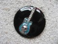 Large fancy brooch, blue guitar, on a black resin background