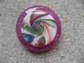 Large fantasy ring, multicolored spiral in fimo, on resin fuchsia background