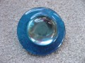 Very large graphic ring, large blue pearl, on a blue resin background