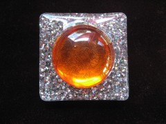 Very large square ring, large orange pearl, on pearl white resin