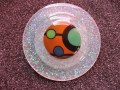 Very very large graphic ring, multicolored cabochon, on a white resin background