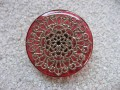 Large graphic ring, silver mandala stamp, on a red resin background