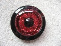 Very large ring, black pearl, on red and black resin