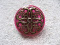 RING graphic, stamp Mandala bronze, on resin fuchsia background