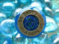 Graphic ring, Be Happy, on blue resin background